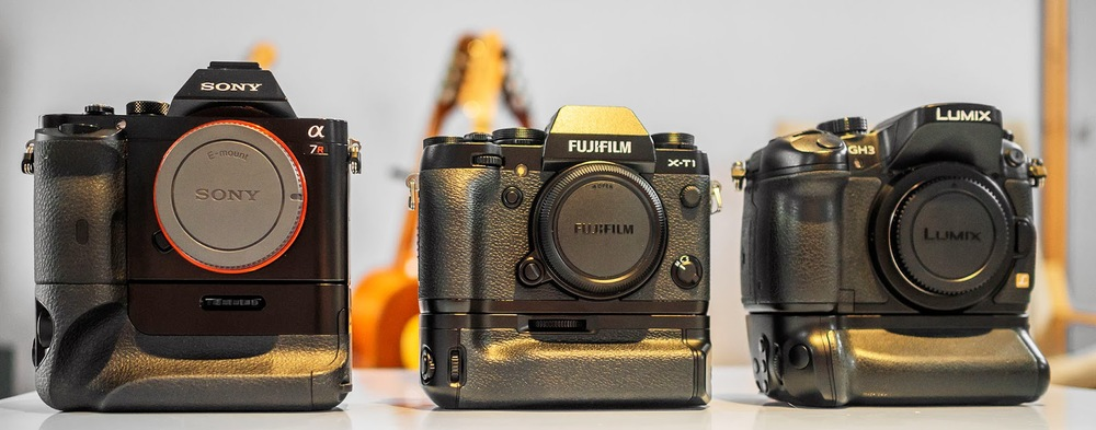Fuji X-T1, Panasonic GH3, Sony A7r all with battery grips.