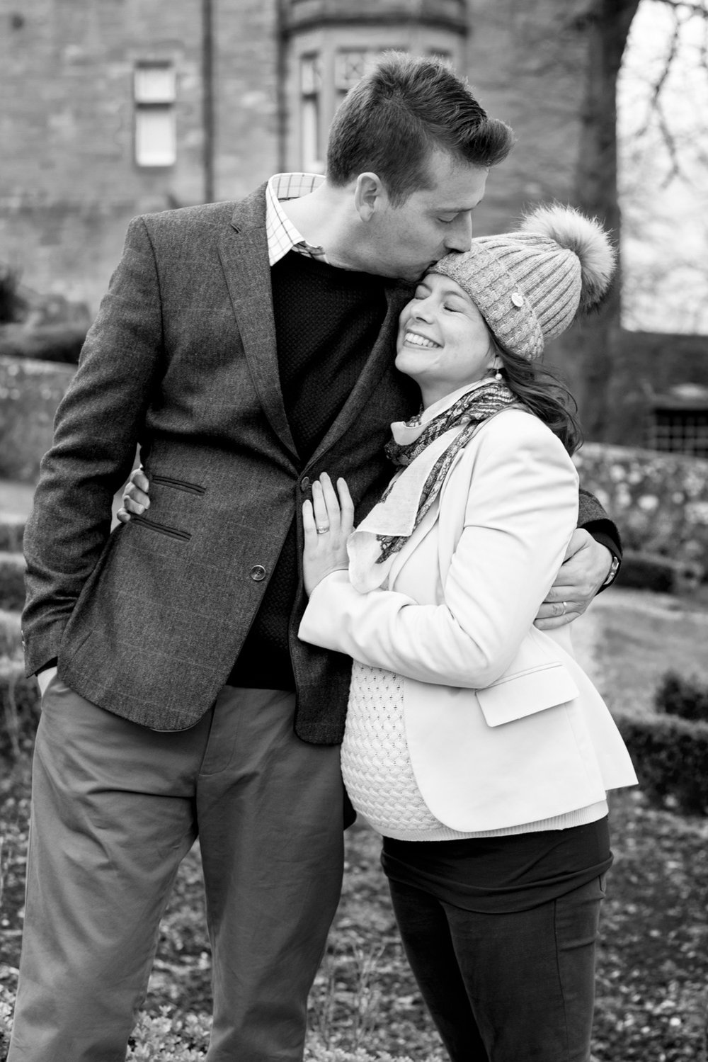 Family Photo Shoot In Dunfermline - couple bump photo