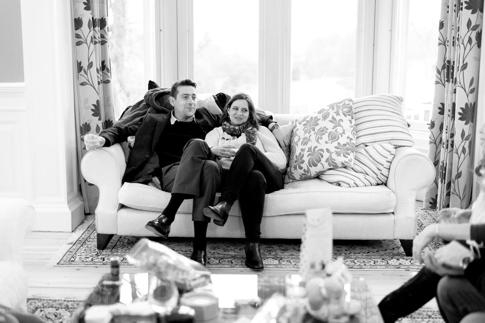 Family Photo Shoot In Dunfermline - couple on sofa at Balmule house