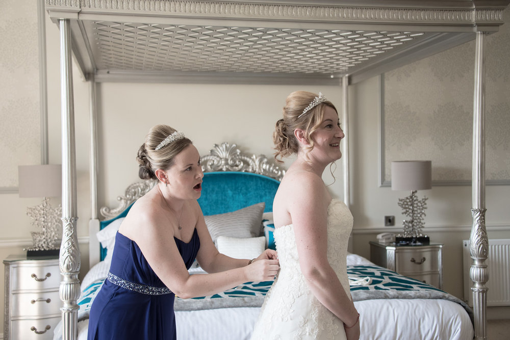 Weddings At Balbirnie House - getting in the dress 01