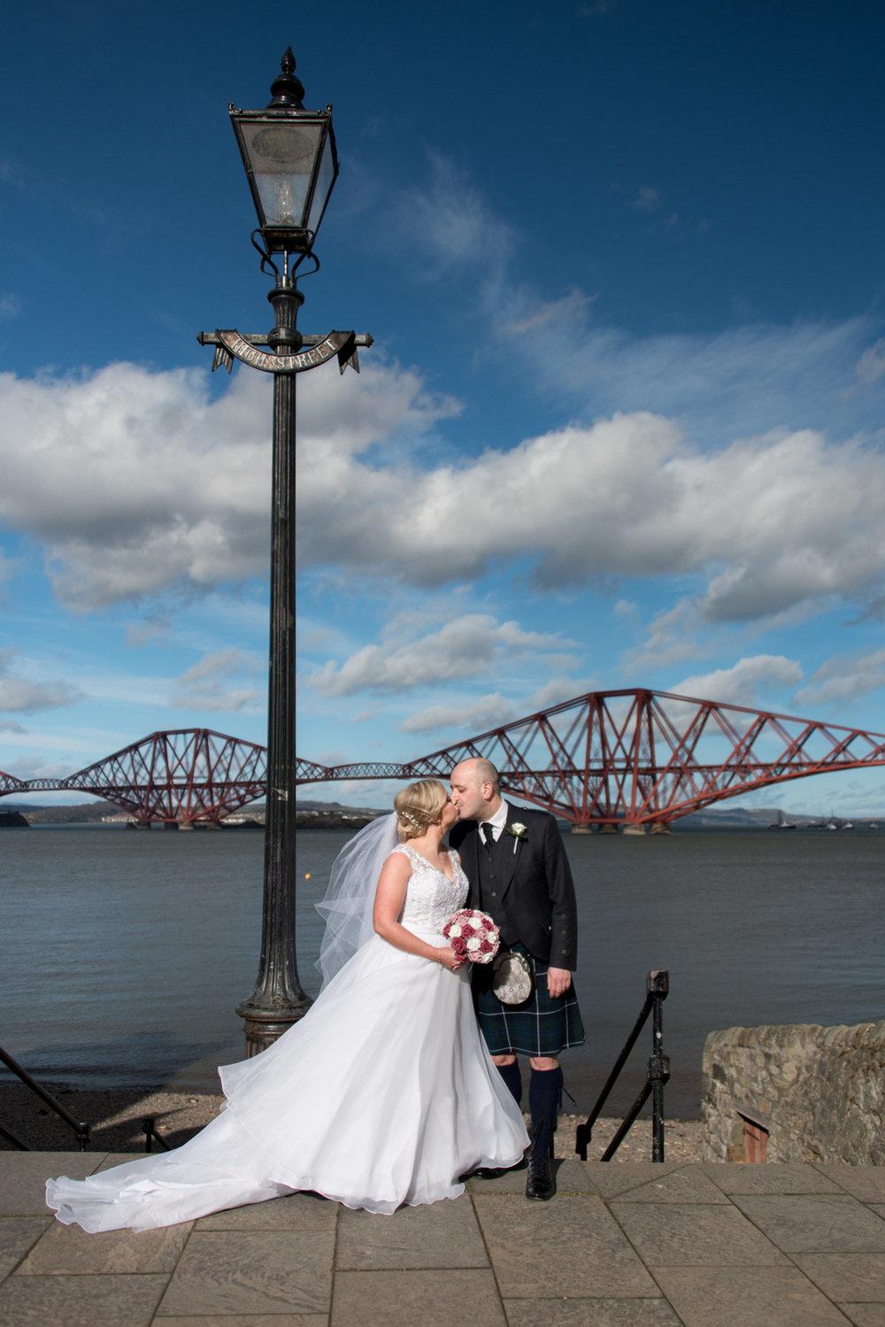 Orocco Pier Wedding - bride and groom bridge photo
