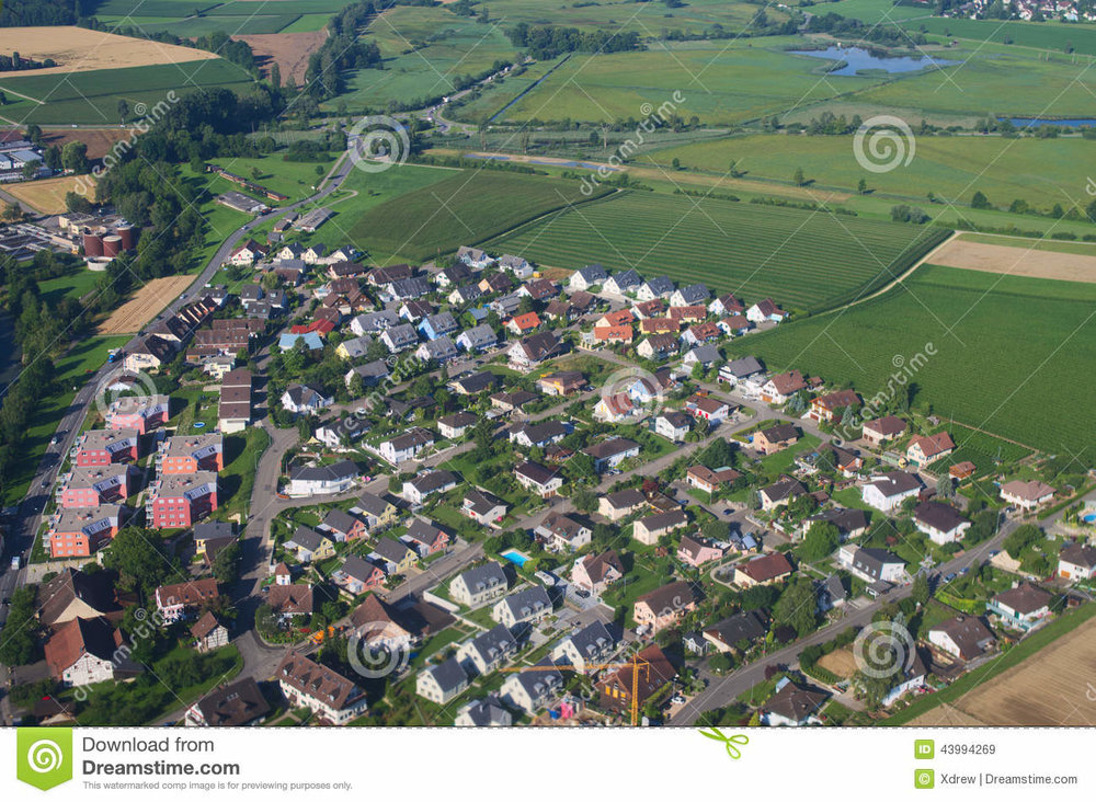 air-view-farm-fields-private-houses-village-switzerland-43994269.jpg