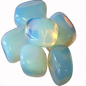 "OPALITE: Milky white or translucent in color, opalite is known as the ""Stone of Eternity"", reminding us we are not limited to our physical selves, but that our souls are eternal. It is a very harmonizing stone and assists during times of transition of any kind. It balances out negative or hostile environments for the betterement of all involved. Opalite improves communication within relationships and on a spiritual level and gives us the courage to speak our minds to promote truth without fear. It also aids in sexual prowess and transforms any negative sexual experiences or events of the past. In matters of health, opalite purifies the kidneys and blood in order to increase levels of vitality in times of extreme fatigue or energy-loss. We are obsessed with the color-play that occurs when the sunshine hits opalite and it seems almost as if the stone itself is radiating an aura about it."