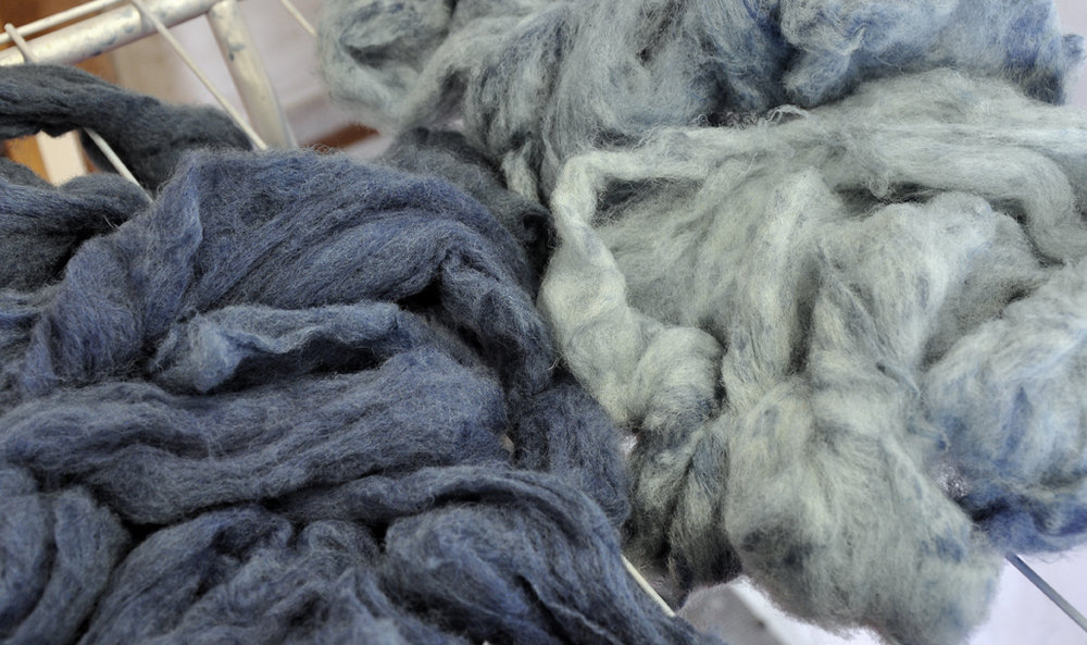 Wool dipped twice on the left, and wool dipped once into the failing dye bath on the right.