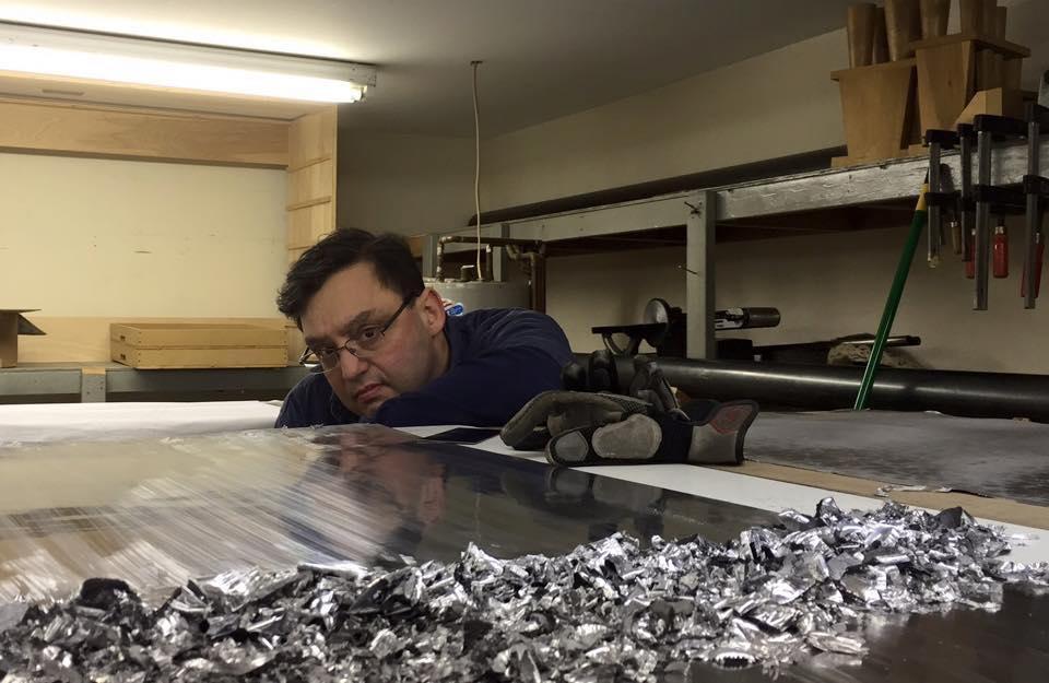 Hand scraping facade metal