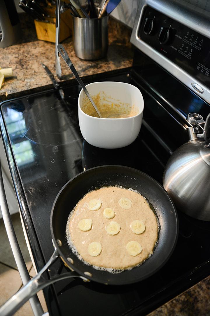 Making banana pancakes.