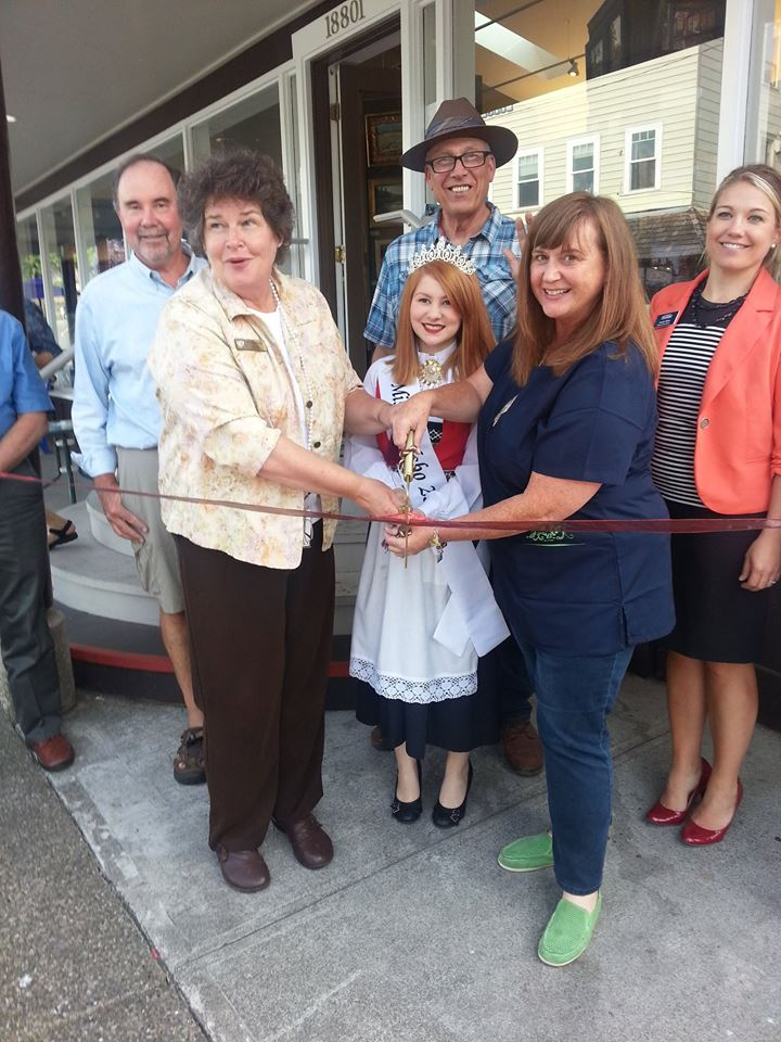 Tim Cleveland, Mayor Becky Erickson, Miss Poulsbo Emily Ward, Jeff Goller, Carrie Goller, Jessie Nino help cut the ribbon at the Goller Gallery on Aug. 7.