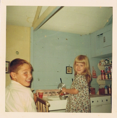 "My brother Kraig and I in the ""kitchen""of our childhood playhouse."