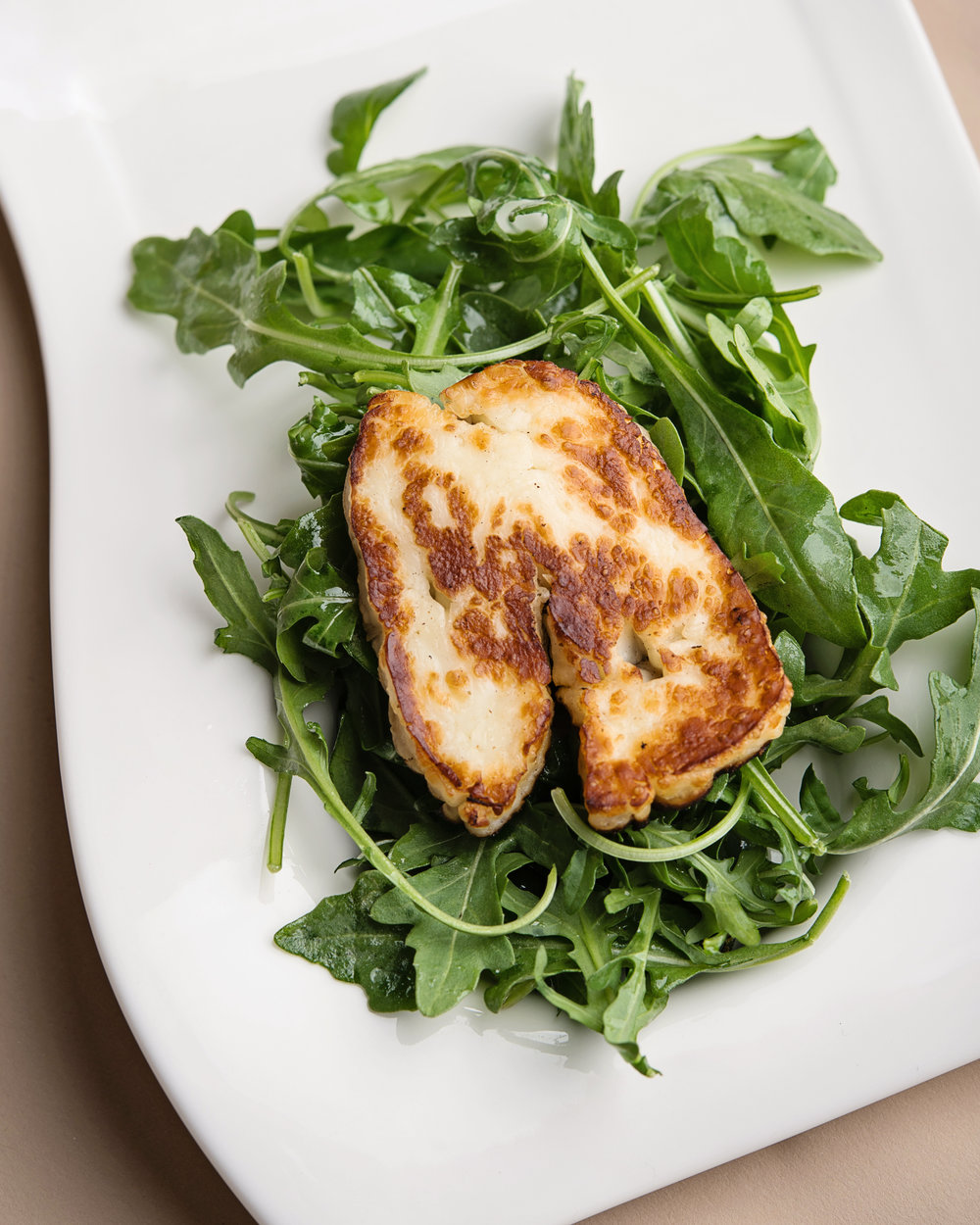 Arugula salad with           grilled halloumi