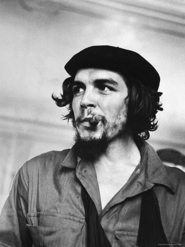 joe-scherschel-cuban-rebel-ernesto-che-guevara-with-lit-cigar-clenched-between-teeth-and-left-arm-in-a-sling_a-G-3834777-4990000.jpg