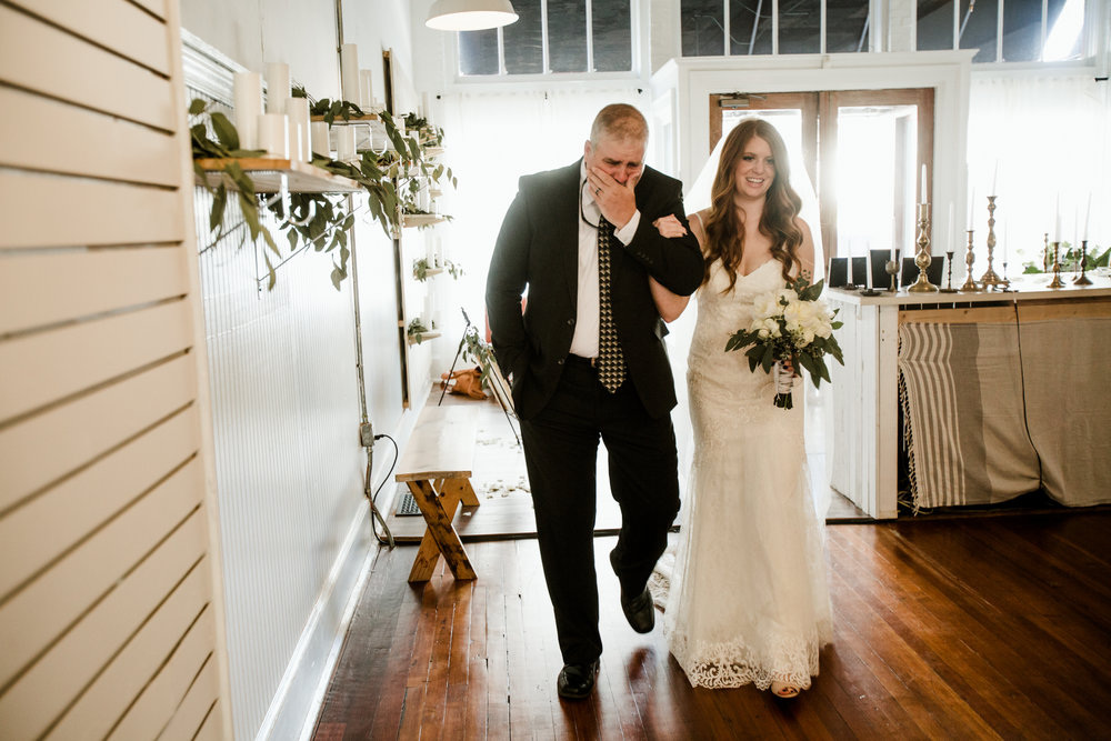 Walking his daughter down the aisle, tears kept coming. -