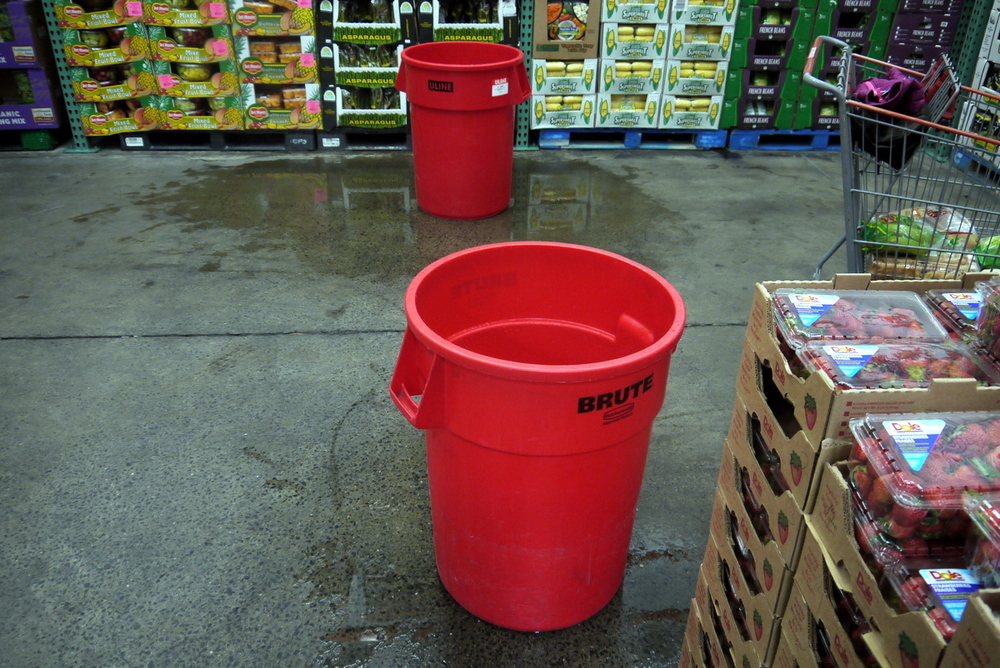 In Costco, two air conditioners were leaking in the refrigerated produce room, and these two brand new red trash cans were catching about 80 percent of the water.
