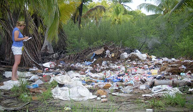 Sea Dragon first mate Emily Penn at a rubbish dump on Kiritimati Island.