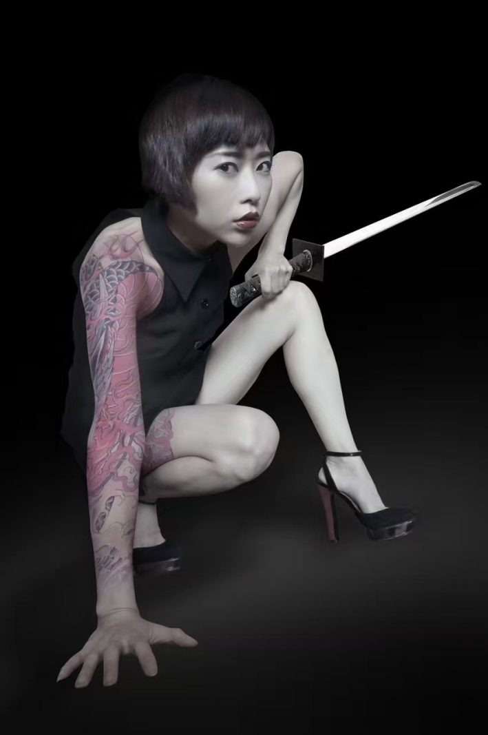 Tan Yuanwu. Tattoos and swords edited in by her husband. Photo credit: Tan Yuanwu.