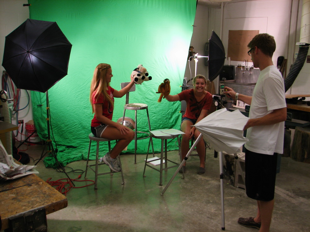 Students performing scripts in front of green screen