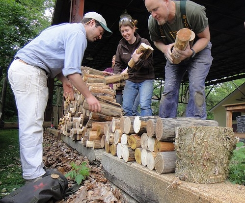 Charles Vinz, Sara Black and Rod Northcutt stacking cordwood for the back wall of the Antioch Tea House (Photo Charles Vinz)