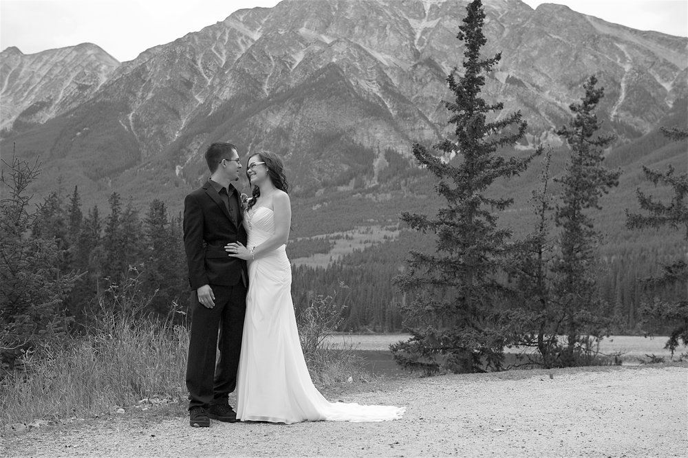 Chris & Melissa, Ceremony held at Pyramid Lake, Reception at The Sawridge, Jasper, AB  Photo Credit: Aislynne's Images