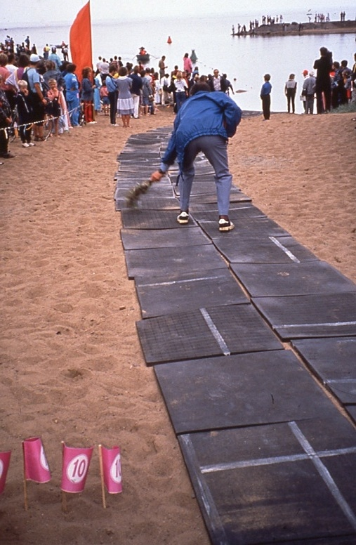 A dedicated crew member sweeps the swimmers' path into the swim, Zelenogorsk, 1990.