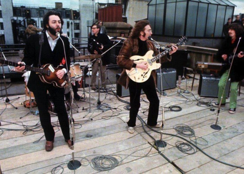 "The band ultimately reached an impasse; Ringo and George vetoed the final proposal. The epic concert in the ""exotic location"" would not materialize, and the compromise was a short and sweet and pathetic rooftop concert one chilly afternoon in London. Disembodied but familiar voices wafted over pedestrians in the street, broadcasted from the same height as church bells or minarets: one final call to prayer for the fanatics down below."