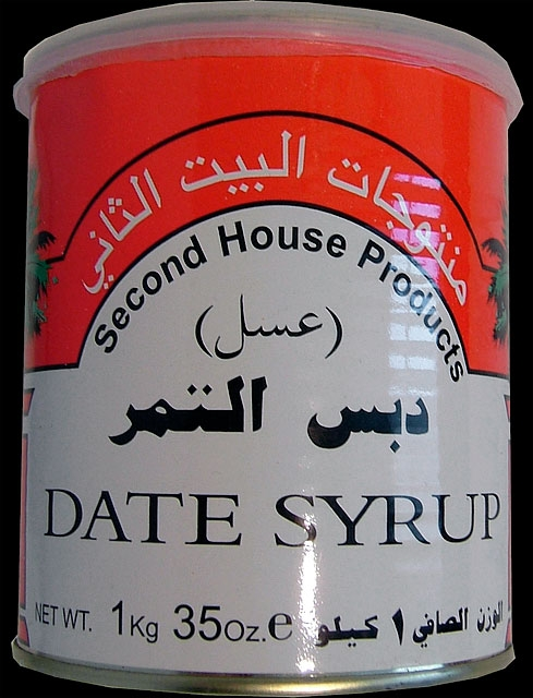 "In addition to continuing the gesture of shipping items, I wanted to explore the possibility of importing something that was clearly labeled as Product of Iraq. This venture began with the discovery of a can of Second House Products Date Syrup. Though stamped on the back as Product of Lebanon, the date syrup is in fact processed in Baghdad, put into large plastic vats, and then driven over the border into Syria, where it gets packed into unmarked aluminum cans. It is then driven across the border into Lebanon where it receives a label and is then exported to the rest of the world. From 1990 until May 2003, this was one method that Iraqi companies used in order to circumvent UN sanctions. It was still in practice in August 2004, more than one year after the sanctions had been dropped, due to prohibitive ""security"" charges levied by U.S. Customs and Border Patrol and Homeland Security for any freight bearing the origin of Iraq.       The date syrup led me to dates, which were legendary in Iraq, with a yield of over 600 varieties. I signed a deal with an Iraqi company, Al Farez, to import one ton of dates from the city of Hilla, the first such deal in more than 25 years."