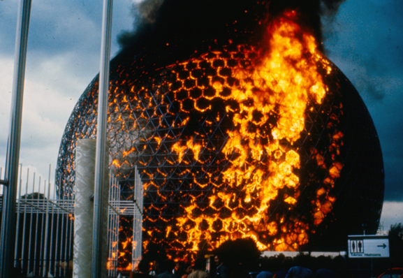 20 May 1976, Montreal—Final preparations for the Summer Olympics were underway when the United States pavilion, a twenty-storey geodesic dome built by Buckminster Fuller for Expo 67, caught fire during routine repairs. The entire acrylic shell was gone within half an hour, the metal structure reduced to one more ruin among the abandoned national pavilions that populated the island. Nine years prior, the site had served as a global playground, virtually insuring the city's bid to host the 1976 Summer Games.