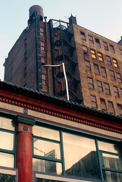 In August 2001, TriBeach Holdings, LLC, opened floors six through eleven of 129 Lafayette Street in Manhattan as the site for a temporary exhibition. Curators were each given a floor of the building with which to work. The exhibition, entitled  GZ:01 , was staged to raise visibility of this vacant building for real estate purposes. Formerly functioning as a large, multi-story community center and business network for the local Chinese community, 129 Lafayette Street was regarded as a prime location for extending SoHo's gallery scene into a new area.