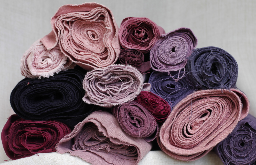 Rolls of antique dyed cloth