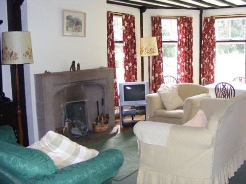 sitting room with bay window and open fire