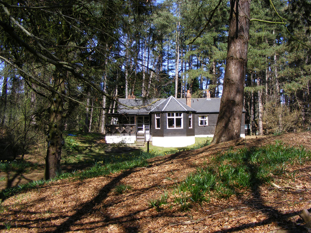 Set within 6 acres of private mixed woodland