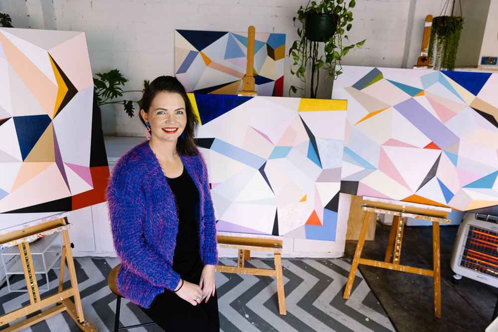 Melbourne artist Susie Monte with her bright, uplifting paintings