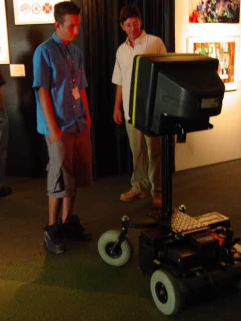V.R. Keith harassing a gallery visitor at SIGGRAPH in 2001.