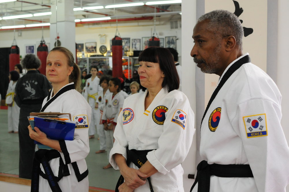 some of the Black Belts suprevising the childrens test.JPG