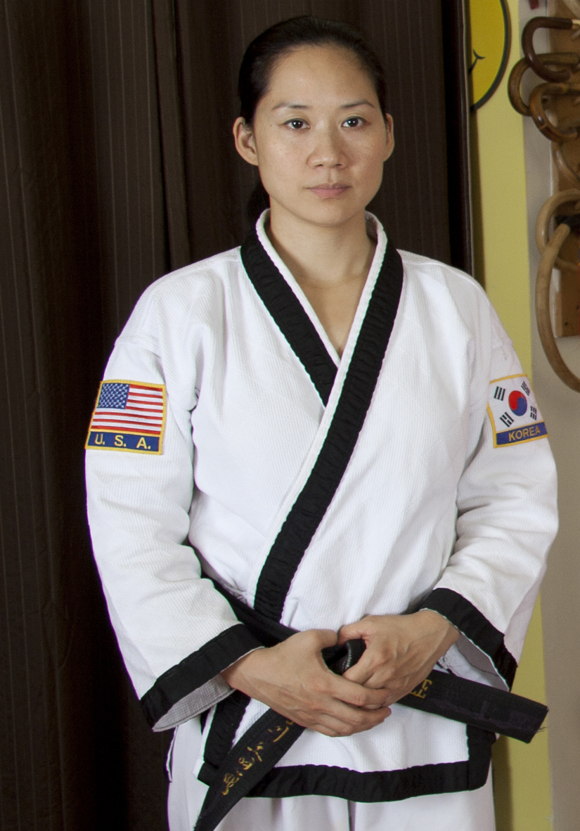 ChungSaNim Master Betty Sze - is a native of NY, and has been training under SaBumNim since 1997. Betty currently holds the rank of 4th Dan in HapKiDo. She has also trained in Wing Chun Kung Fu, Shaolin Kung Fu, Judo, and Jujitsu. Betty holds the rank of 3rd Dan under Soke John Davis in Kumite Ryu Jujitsu. A 3 year stint as a personal trainer and kickboxing instructor, studying directly under a former Mr. America, gave her a solid foundation in the anatomy of the body. Her main goal is to promote martial arts to the world as a way to achieve spirituality, health and empowerment.