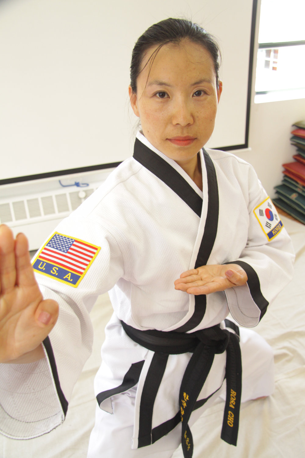 Senior Instructor Rosa J. Cho  has been studying HapKiDo under Master Herbert at WMAC since 2001 and is a 2nd degree black belt.  She has also studied wushu, kickboxing, yoga and swing dancing. Believing in the power of achieving health through empowering one's mind, body and soul, she brings a lot of positive energy and enthusiasm to every class and cares for each student's paths to well-being and empowerment. Rosa recently earned a Ph.D from the NYU Silver School of Social Work, and is working on socioeconomic justice and women's rights issues.