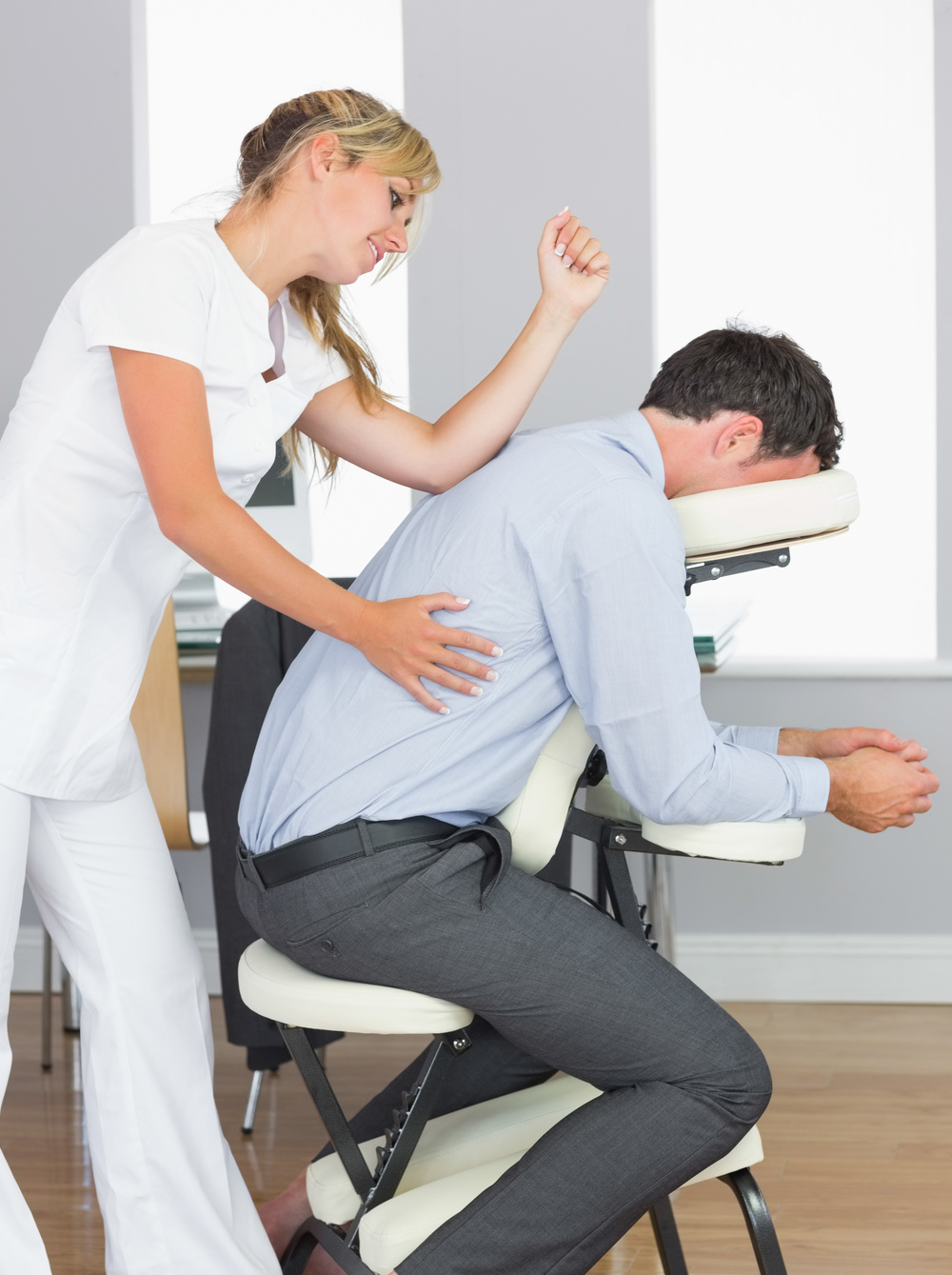 Massage Therapist Practicing Spinal Reflex Therapy
