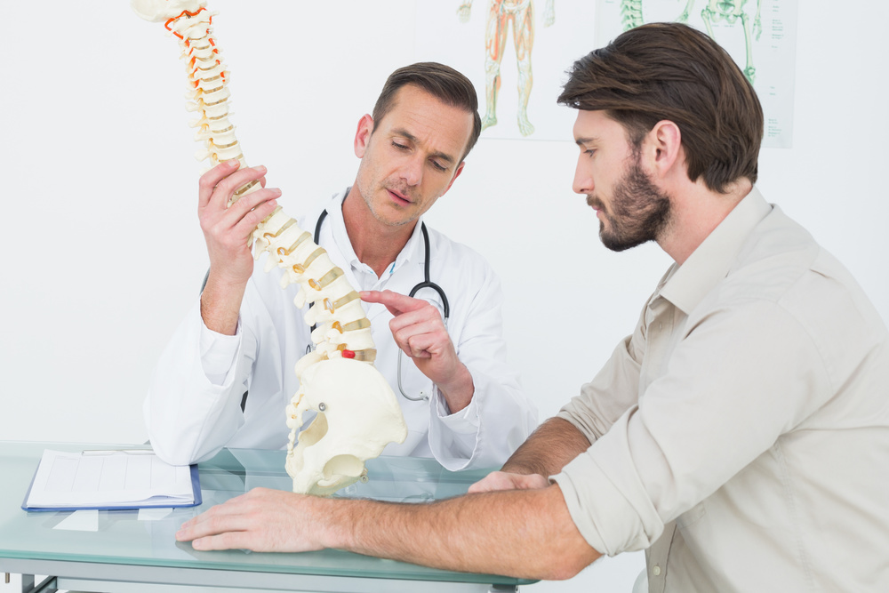Physician Explaining Spinal Reflex Analysis Diagnostics & Treatment