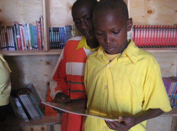 Most rural students, their families and their teachers had never had access to books (other than textbooks) before. At this level, learning to read begins with learning how to open a book, and how to turn a page.
