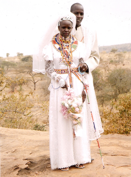 Florence and her husband, Henry, on their wedding day in 2009, Isinya. Along with her beautiful wedding dress, she is adorned with traditional Maasai beaded jewelry.