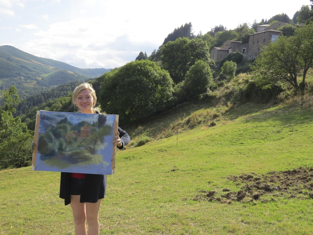 a student with her pastel landscape drawing les tapies summer programs