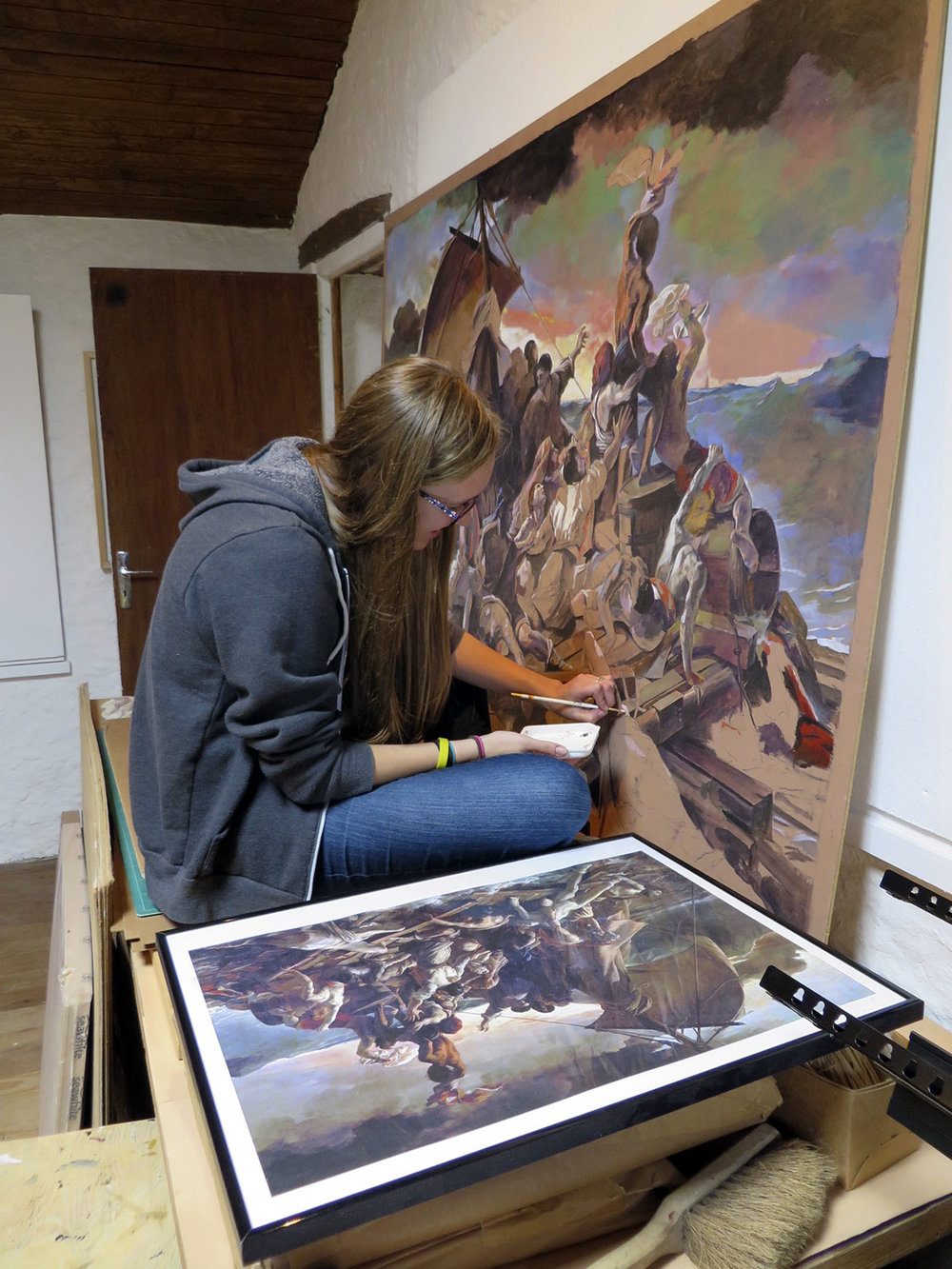 high school student working on a painting study of raft of the medusa