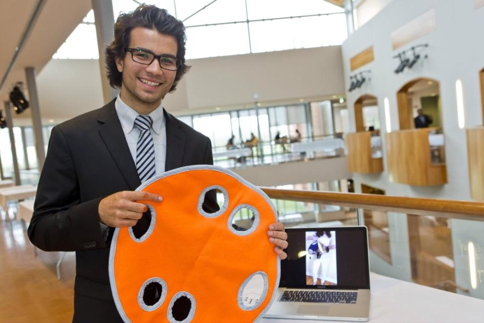 Bryce Bandish displays the Pet Pita at Clarkson's Innovation Showcase in 2013.