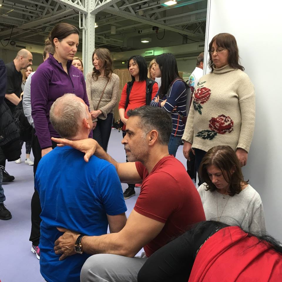 Mas works on a visitor during the Mind Body Spirit Festival in London, UK.