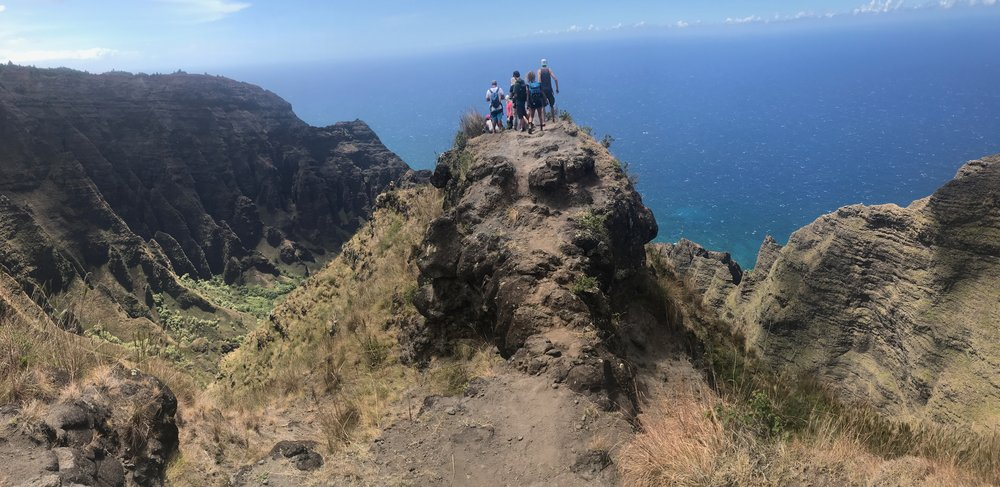 Retreat participants enjoy a view of the famous Napali Coast during a hike on the Waimea Canyon Retreat.