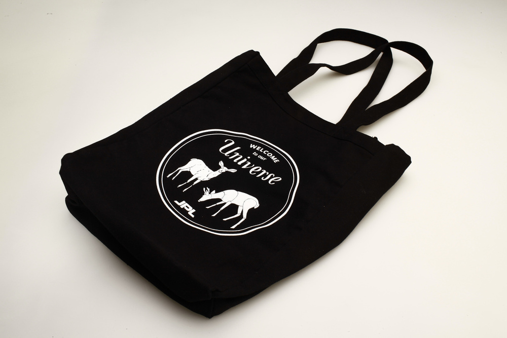 Tote bag holds all Welcome Pack materials and was designed with re-usability in mind. The image features two deer: one robotic, one real.