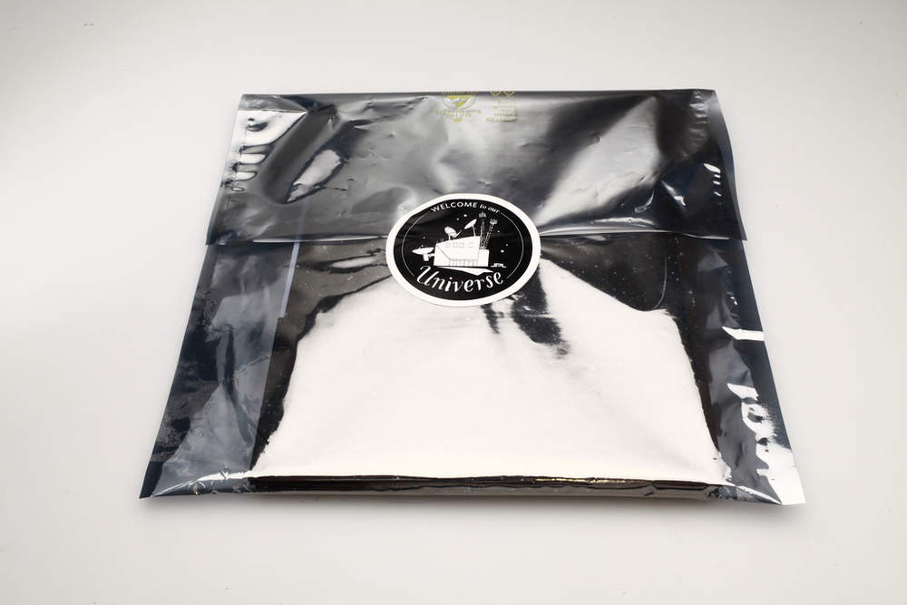 "Materials arrive in an official regulation anti-static bag and sealed with a 'Welcome to Our Universe"" sticker."