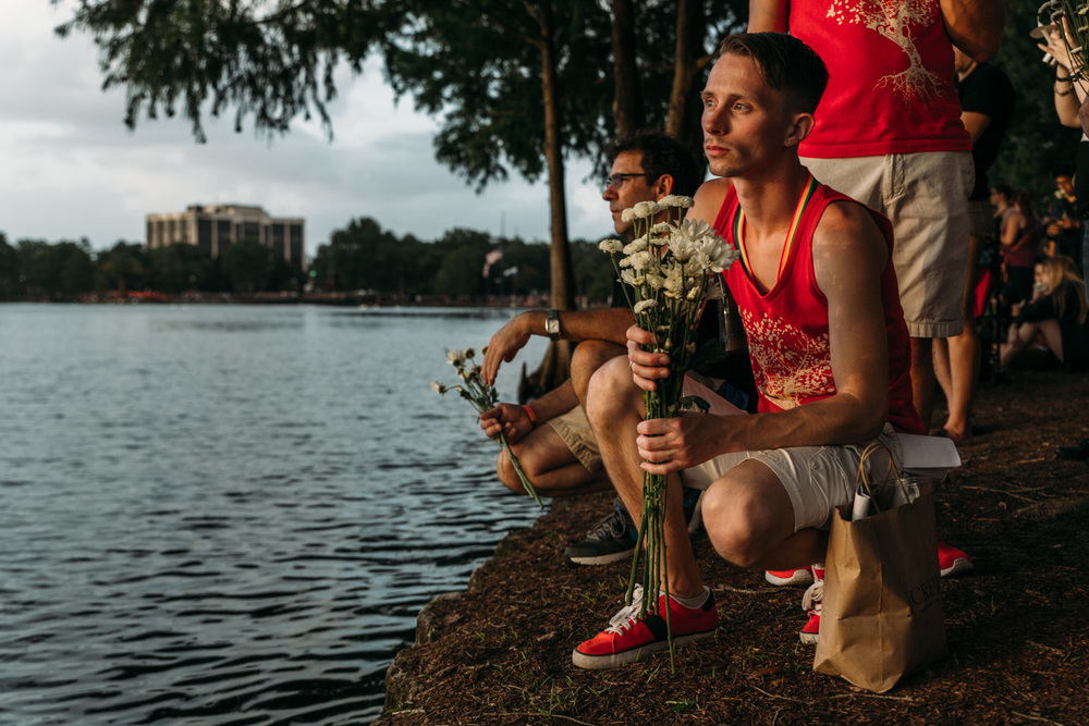 This man sat at the water's edge and gave out flowers to any who wanted one.