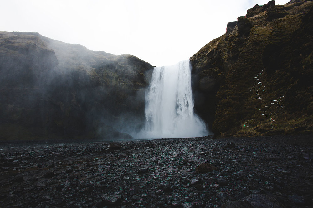"Followed by this (seemingly) deserted giant waterfall aka: Skógafoss. There are about 30 other tourists behind me. I'm not gonna lie and say ""Woke up at 4AM to be alone at *insert Iceland location here*"" cause it's about a 3.5 hour drive and the jet lag was real."