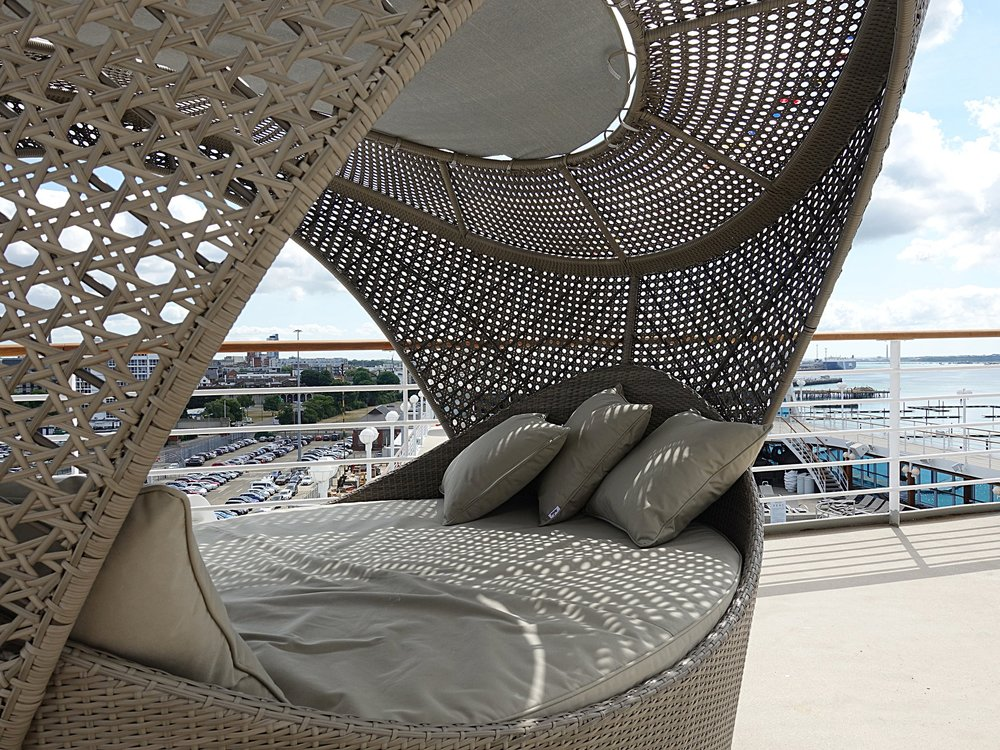 Oval shaped canopied day beds on the upper decks.