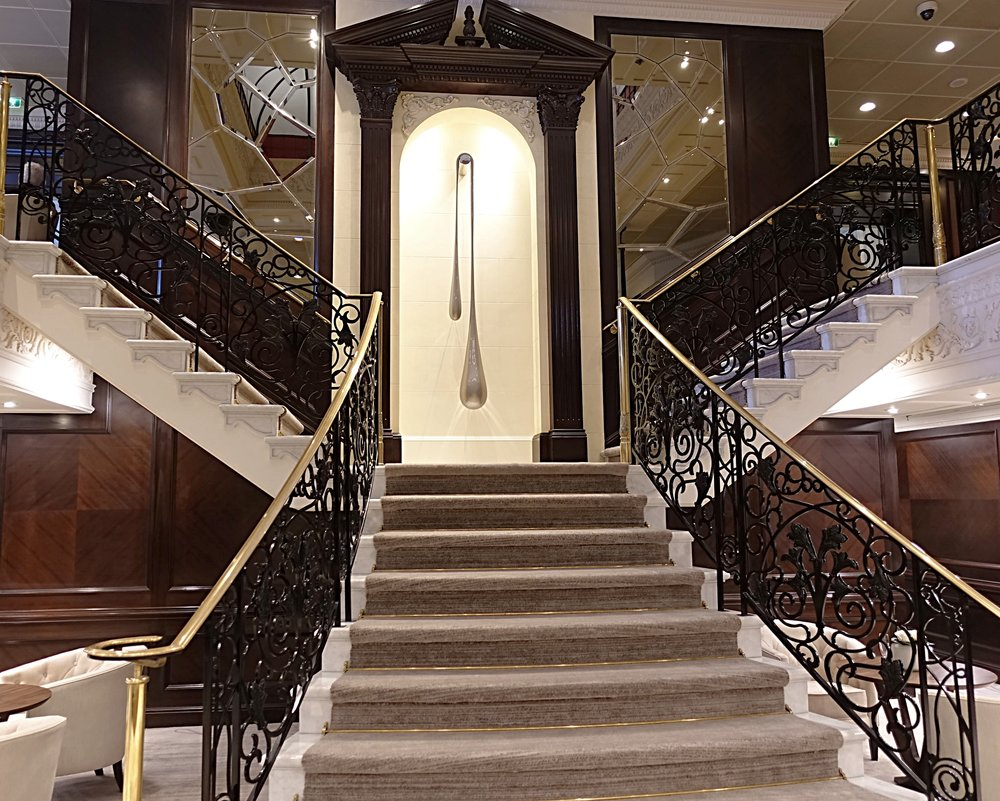 The elegant staircase in the main atrium.