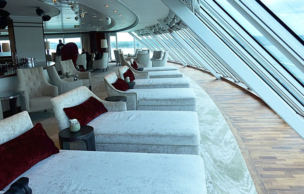 Sumptuous daybeds with a panoramic view over the bow of the ship.